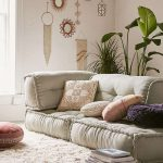Living Room, Brown Floor, Fur Rug, Grey Floor Seating, White Wall, Bohemian Accessories, Plant Pot