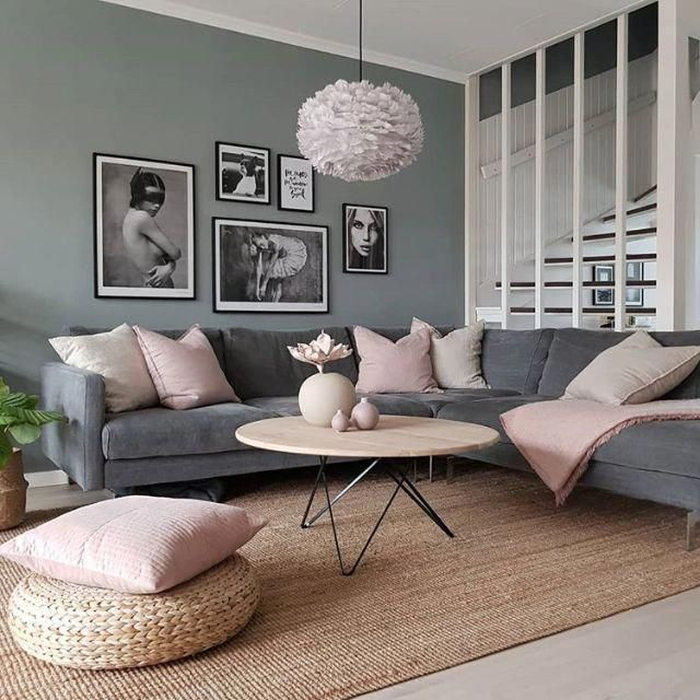 living room, brown wooden floor, rattan rug, grey wall, grey velvet corner sofa, round wooden table, white pendant, rattan ottoman