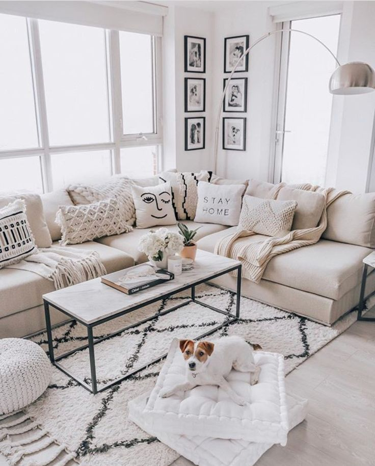 living room, light wooden floor, white wall, white sofa, white marble coffee table, silver floor lamp