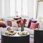 Living Room, Pink Rug, Black Round Coffee Table, Black Side Table, Grey Sofa, Pink Grey Red Pillows, White Wall