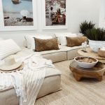 Living Room, Rattan Rug, White Corner Sofa, Wooden Round Table, White Pots