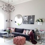 Living Room, White Rug, White Wall, Black Chandelier, Black Sofa, Pink Tufted Ottoman, Round Mirror, Coffee Tbale
