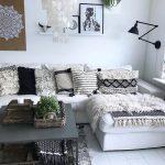 Living Room, White Wooden Floor, White Wall, White Floating Shelves, White Corner Sofa, Black Coffee Table, Black Sconces, White Pendant