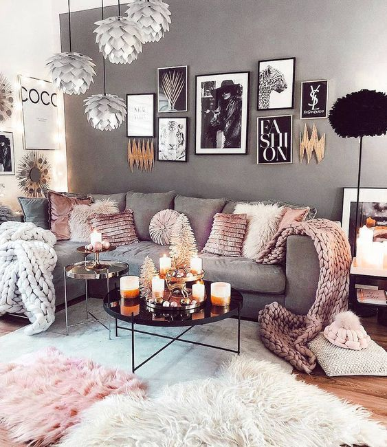 living room, wooden floor, grey rug, grey wall, white wall, silver pendants, grey corner sofa, black tray coffee table