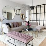 Living Room, Wooden Floor, White Rug, Grey Sofa, Round Mirrors, Pink Tufted Bench, Coffee Table Black Glass Top