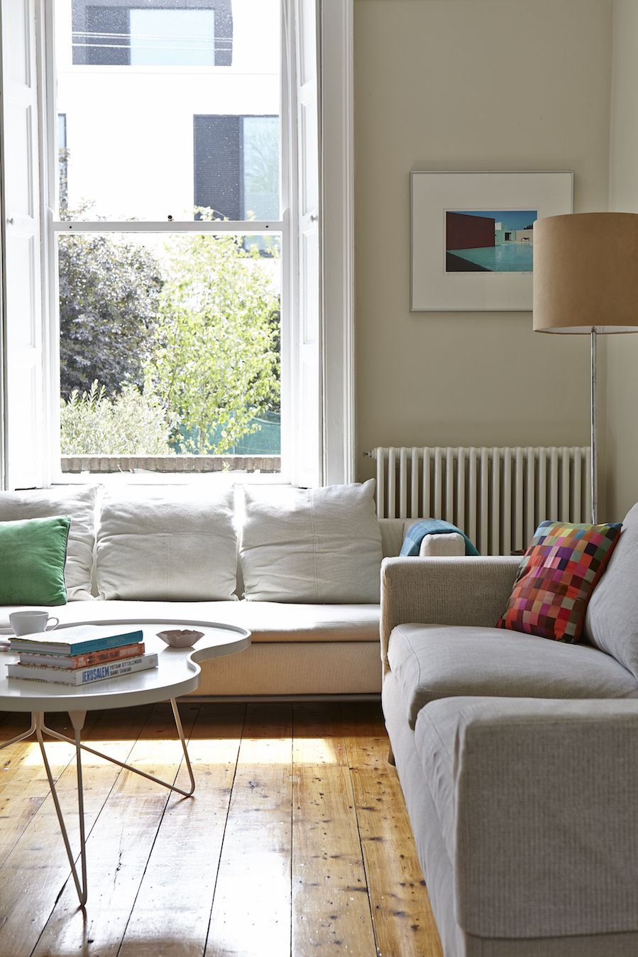 living room, wooden floor, white tray coffee table, grey sofa, white sofa