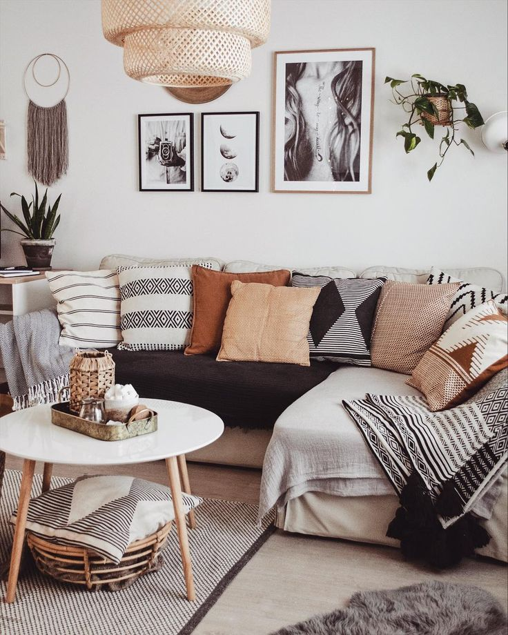 living room, wooden floor, white wall, grey corner sofa, white round coffee table, rattan pendant