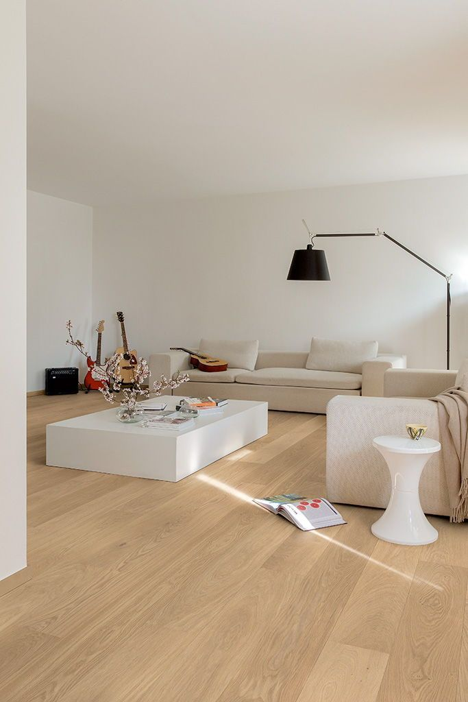 living room, wooden floor, white wall, white sofa, black floor lamp, white square coffee table