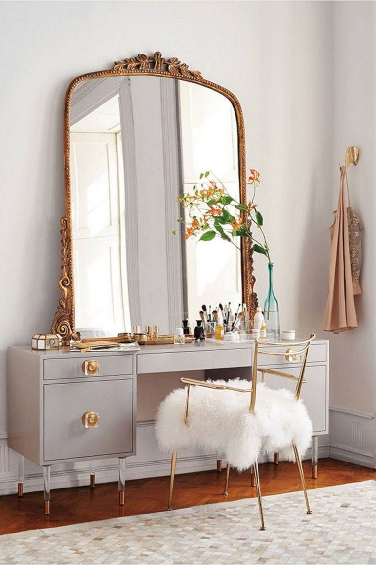 make up station, wooden floor, light grey cabinet, golden french mirror, golden chair,