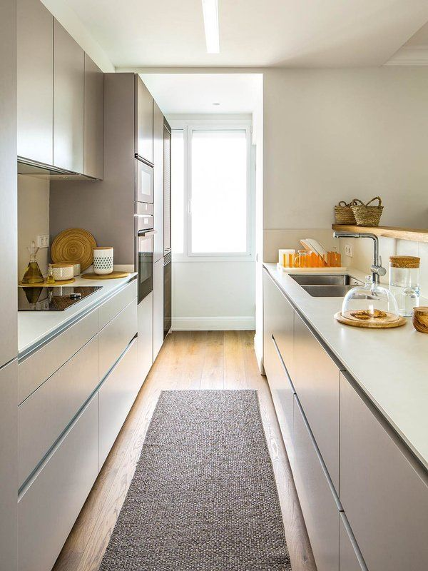 narrow kitchen, smooth cabinet, wooden floor, white counter top, brown rug