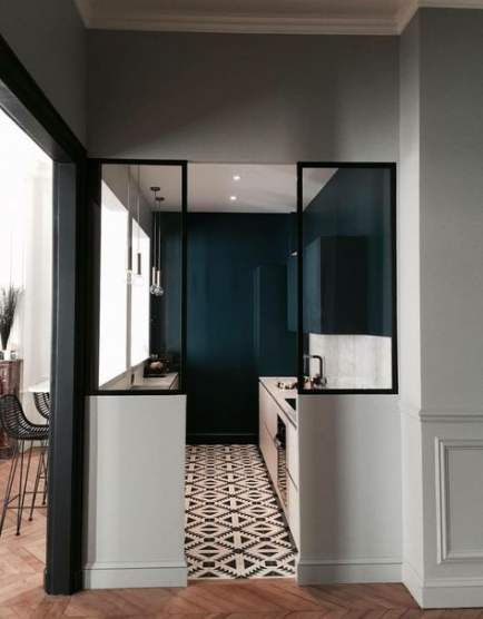 narrow kitchen, white cabinet, dark green wall, patterned floor