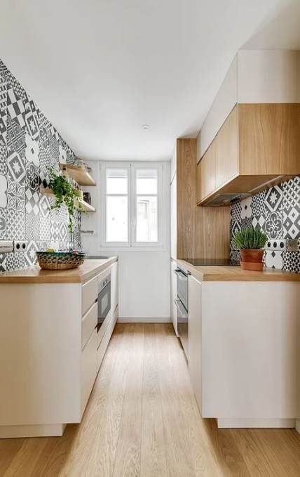 narrow kitchen, wooden floor, patterned wall, white cabinet, wooden counter top, wooden cabinet, white wall