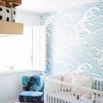 Nurser, Wooden Floor, White Rug, White Wall, Patterned Wall, White Crib, Wooden Floating Shelves
