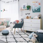 Nursery, Grey Floor, White Patterned Rug, White Cabinet, Wooden Crib, White Wall, Green Chair, Green Ottomans