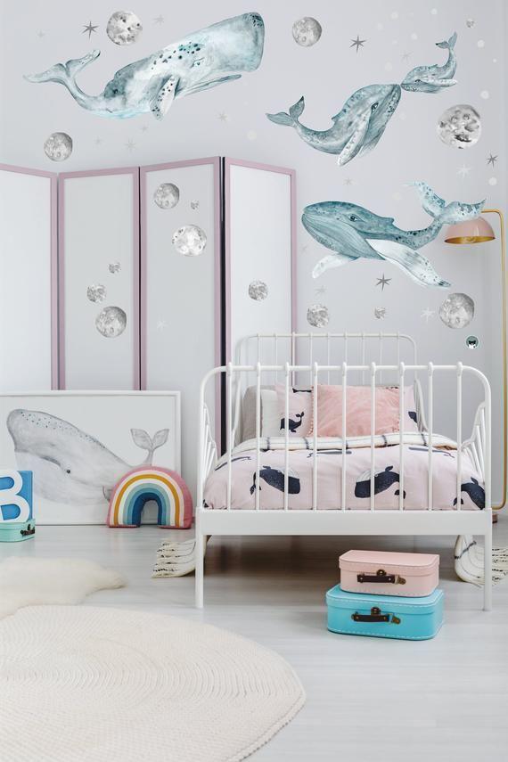 nursery, white seamless floor, white iron crib, wall decals, white round rug