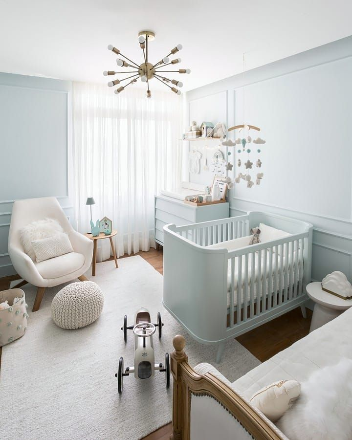 nursery, white wall, white crib, white cabinet, wooden floor, white rug, white chair, white woven ottoman