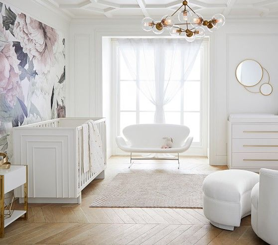 nursery, wooden floor, white wall, white chair, white ottoman, white sofa, white crib, flowery accent wall, accent ceiling, white cabinet