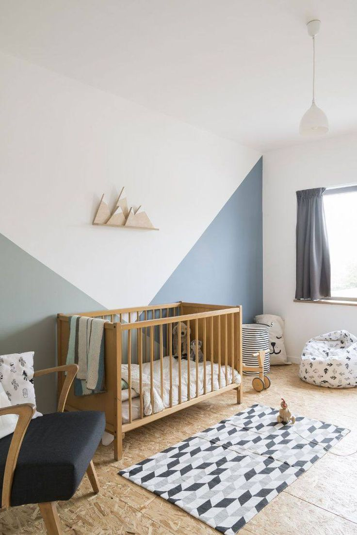 nursery, wooden floor, white wall, wooden crib, white pendant, black chair