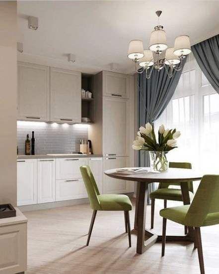open kitchen, white kitchen cabinet, white subway backsplash, wooden floor, pendants, round dining table, green chairs