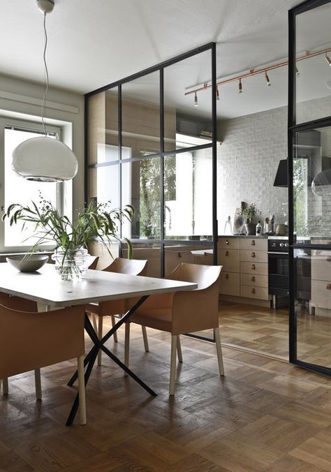 open room, wooden floor, white wall, wooden kitchen cabinet, glass partition, white dining table, wooden chairs, white pendant