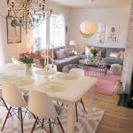 Open Space, Wooden Floor, Pnk Rug, Pink Patterned Rug, White Dining Set, Grey Sofa, Glass Top Round Coffee Table, White Pendant, Chandelier