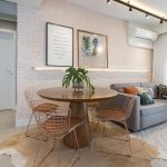 Open Space, Wooden Floor, White Exposed Wall, Grey Sofa, Golden Round Tulip Table, Copper Chairs