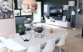 open space, wooden floor, wooden dining room, white modern chairs, glossy pendant, pink wall, black wall, grey sofa, white cabinet