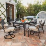 Outdoor Dining Room, Brick Floor, White Wall, Black Dining Set, Brown Cushion, Accent