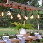 Outdoor Dining Room, Bulbs Above On Wooden Rod, Long Wooden Table, Long Wooden Bench