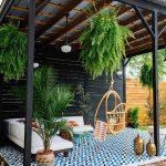 Patio, Blue Patterned Floor, White Corner Sofa, Rattan Swing, Green Coffee Table, Plants
