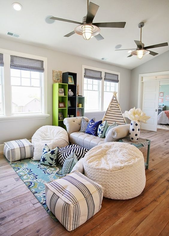 playroom, wooden floor, white sofa, beanbags, tent, shelves, ceiling fan
