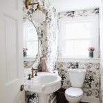 Powder Room, Black Floor, Flowery Wall, White Sink, White Toilet, White Sconce, Round Mirror