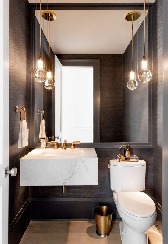 powder room, black wall, white floating marble sink, white toilet, glass bulb pendant