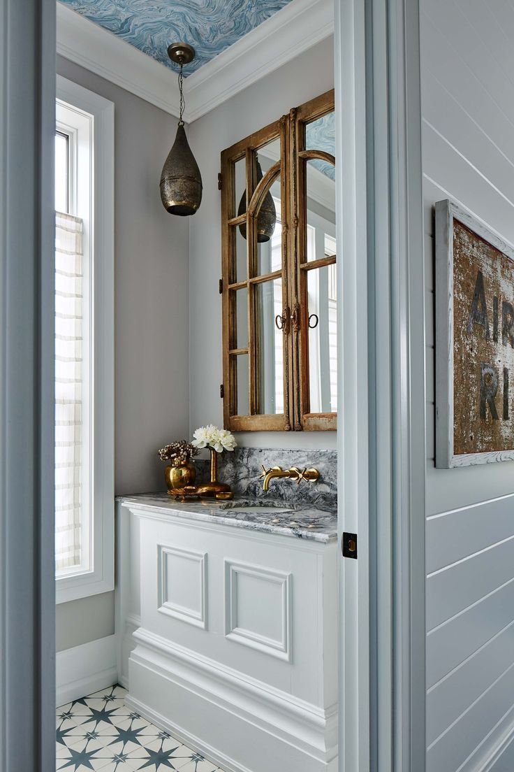 powder room, white wainscot vanity, grey marble, grey wall, golde faucet, wooden door for mirror, black pendant