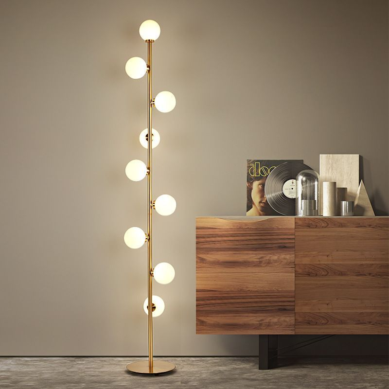 white bulubs in golden line on floor lamp