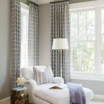 White Lounge Chair, Side Table, White Floor Lamp, Patterned Curtain, Brown Rug