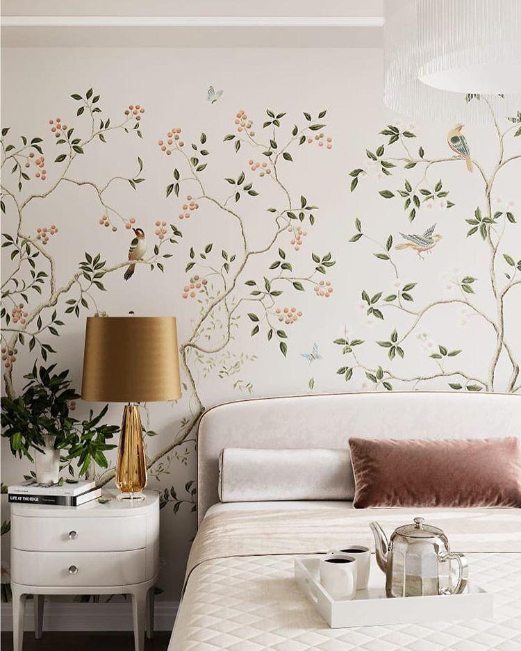 white velvet headboard, flowery wall, white side table, golden table lamp