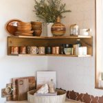 Wooden Corner Shelves, White Geometrical Wall Lines, Wooden Cabinet With White Top