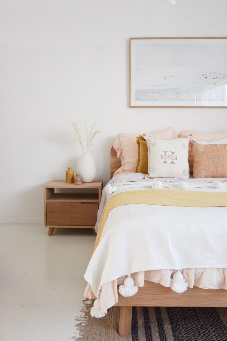 wooden headboard, white seamless floor, white side cabinet