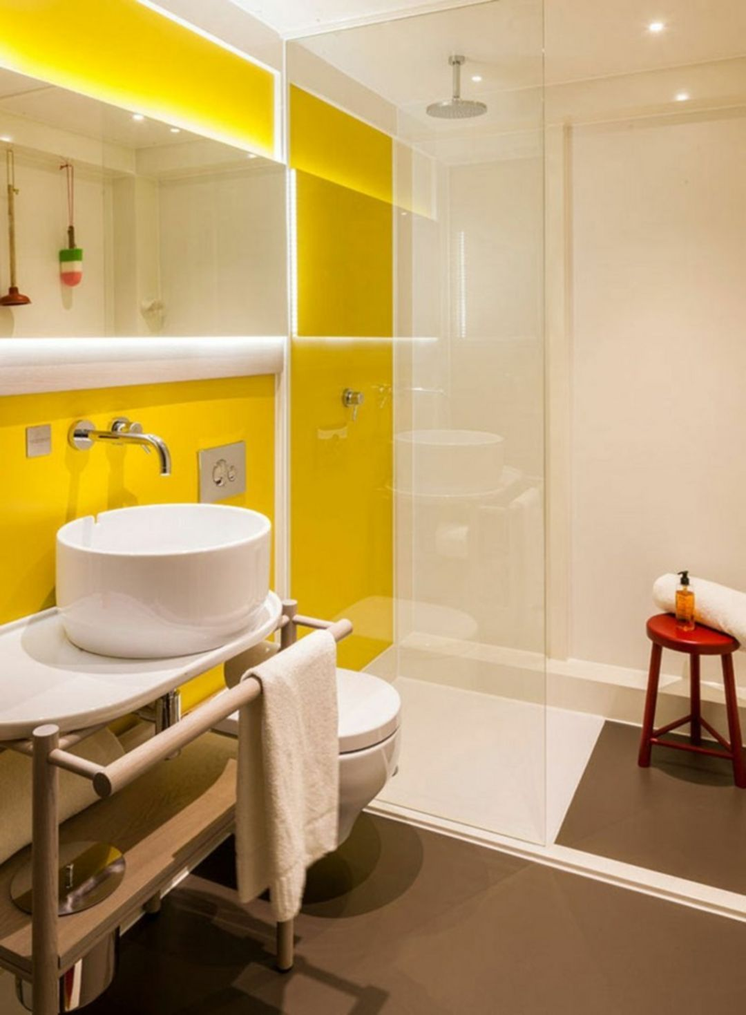 yellow bathroom, yellow wall, white wall, white sink, white vanity, white toilet, brown floor