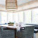 Banquette, Wooden Floor, White Built In Bench, Blue Cushion, White Wall, Glass Window, Rattan Pendant, Dark Patterned Chair, Wooden Table