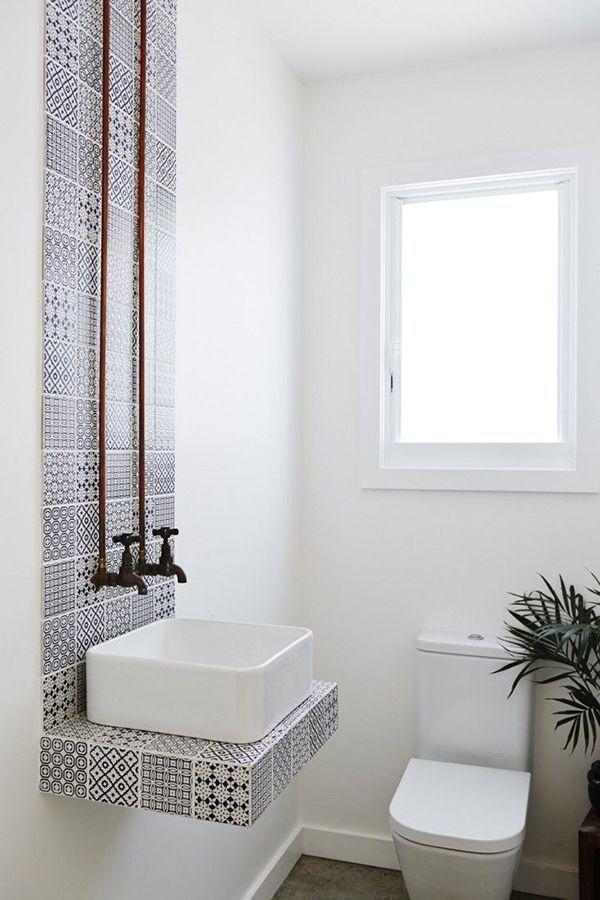 bathroom, grey floor, white wall, patterned tiles floating vanity, white sink, white toilet