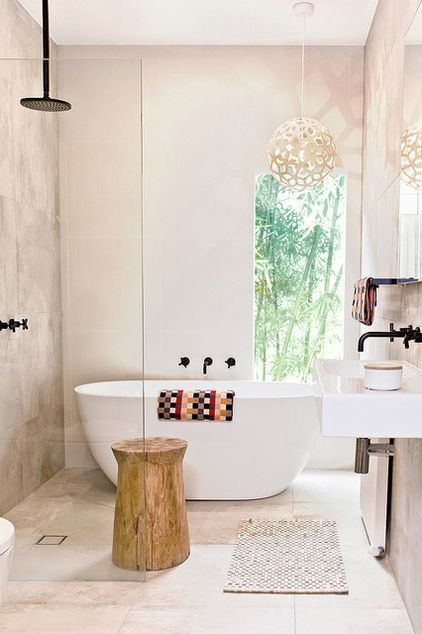 bathroom, marble floor tiles, marble wall tiles, white tub, wooden side table, pretty pendant, white floating vanity