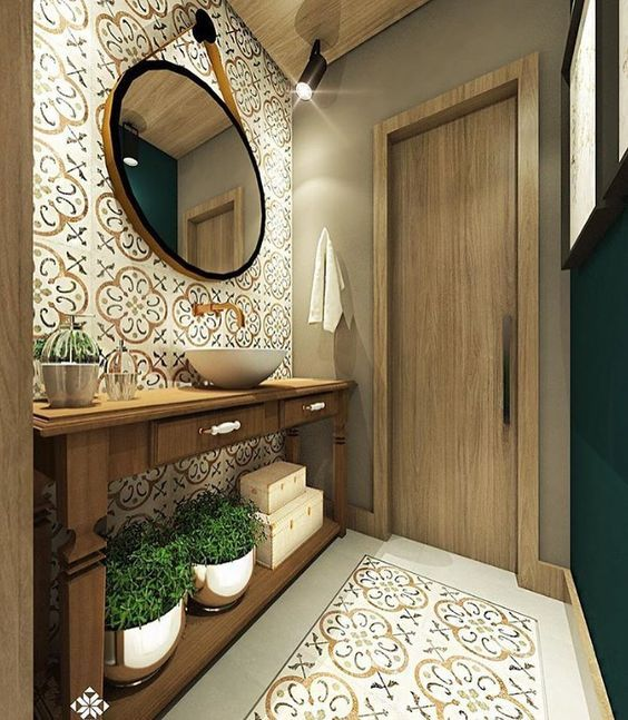 bathroom, patterned floor tiles, patterned wall tiles, wooden table, white sink, round mirror