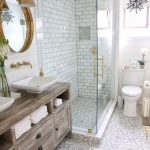 Bathroom, White Patterned Floor, White Shiplank, White Subway Wall, White Toilet, Wooden Cabinet, Round Mirror, White Sink