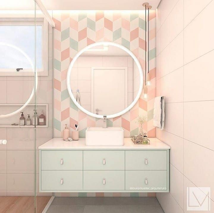 bathroom, white wall, colorful pastel backsplash, white round mirror, green floating vanity with white top, white sink