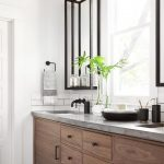 Bathroom, White Wall, Wooden Cabinet, Marble Top, Black Iron Mirror With Shelves, Glass Bulb Adjointed Sconces