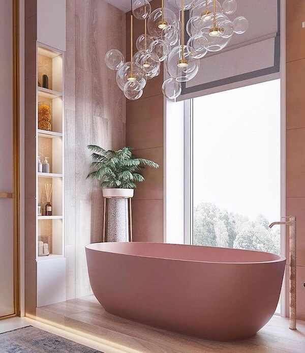 bathroom, wooden floor, built in shelves, brown wall tiles, glass pendants, pink tub, glass window