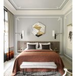 Bedroom, White Floor, Grey Patterned Rug, Grey Wall, Grey Accent Ceiling, Brown Headboard, White Sconces, Grey Bench