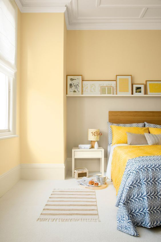 bedroom, white floor, light yellow wall, yellow bedding, floating shelves, white side table